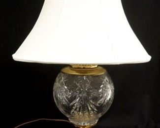 1002	LARGE CRYSTAL LAMP ON A HEAVY BRASS BASE