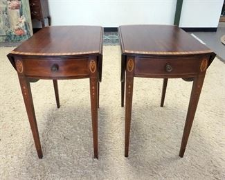 1003	PAIR OF OVAL MAHOGANY BANDED ONE DRAWER DROP LEAF TABLES W/ BELL FLOWER INLAY. 39 IN OPEN 18 1/2 IN W CLOSED, 28 IN  X 29 IN