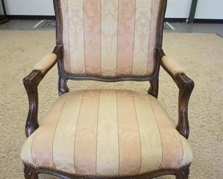 1010	FRENCH PROVINCIAL CARVED UPHOLSTERED ARM CHAIR