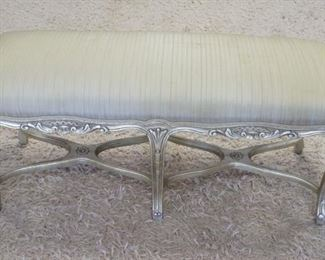1011	UPHOLSTERED WINDOW BENCH W/GILT SILVER FINISH ON CARVED WOOD, SOME STAINING ON UPHOLSTERY, 43 1/2 IN X 16 IN X 19 IN HIGH