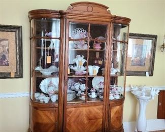 "2.) Continental Vitrine (Belgium) walnut, mahogany. A one part form with central door and blind base on cabriole legs. 84""h x 60""w x 24""d.  Circa 1910."