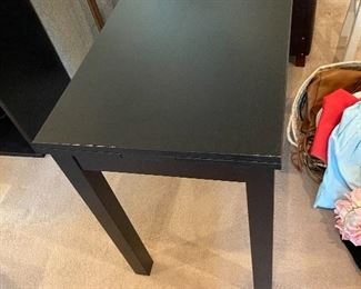 Versatile black table with two extensions that pull out. 35 1/2 inches wide by 19 and three-quarter inches deep by 29 inches high.  Pull out extensions add another 7 1/2 inches on each side. $60. new $260