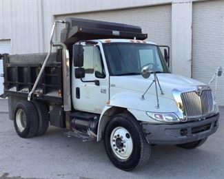 """VIN 1HTMMAAR16H261532 Year: 2006 Make: International Model: 4300 SBA Trim Level: Dump Truck 4x2 Engine Type: 7.6L L6 Diesel Transmission: Automatic Miles: 202,507 Color: White Buyer Premium 10% BP Located in: Chattanooga, TN Operational Status: Runs, Drives, and Operates *When Driving """"Engine"""" Light will Come on But Will Go Away* *Rough Cold Start* Manual Windows Manual locks Vinyl interior AC/Heat Tested-Works Dump Bed Size - 10'L x 8'W **Sold as is Where is**  2-68"""