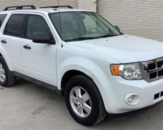 VIN 1FMCU0DG6BKA56830 Year: 2011 Make: Ford Model: Escape Trim Level: XLT 4WD Engine Type: 3.0L V6 Transmission: Automatic Miles: 73,330 Color: White Buyer Premium 10% BP Located in: Chattanooga, TN Operational Status: Runs and Drives Power Windows Power Locks Power Mirrors Power Seats Cloth Interior Heat/AC Tested Works **Sold as is Where is**  1-25
