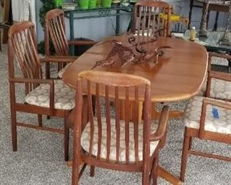 Teak dining set with 6 chairs & 2 extra table leaves. Made  in Thailand by Benny Linden Designs