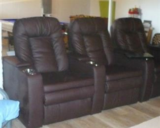 THREE THEATER  RECLINERS . HAVE A SNACK, SET BACK AND ENJOY   YOUR FAVORITE MOVIES