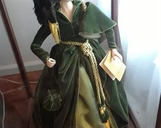 Scarlett O'Hara doll wearing the glorious green dress, standing in case