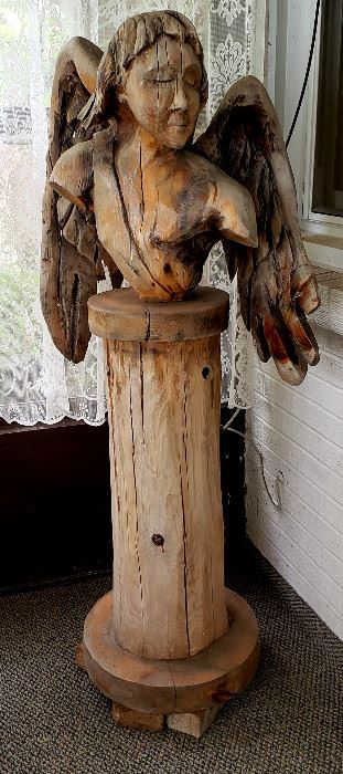 Wood carving:  Angle bust