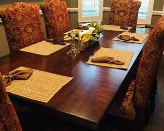Large Cherrywood Dining Table that comes with two leaves. Can accommodate 12 people with the leaves inserted.