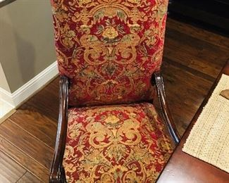 Red patterned dining chairs. Two armchairs and four side chairs.