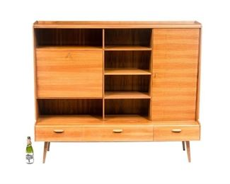"""Danish Mid-Century DeWe sideboard, open shelves, geometric motif, single drop front door opens to mirrored interior with glass shelf, single door, above three drawers, includes two keys, rising on pin legs. 59""""h x 69""""w x 12""""d"""