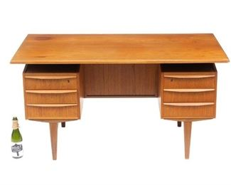 """Danish Mid-Century executive desk, six drawers flank knee hole, single door on back, elevated writing surface, includes key, rising on pin legs. 29.5""""h x 57""""w x 29.5""""d"""