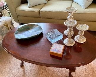 Oval cherry coffee table, mercury glass candlestick trio.