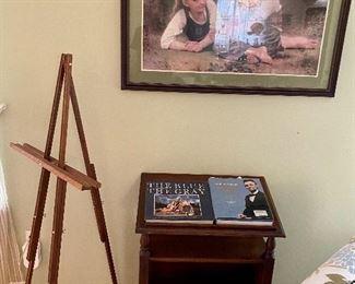 Framed pastoral print & book table.