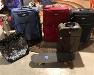 luggage & a skateboard