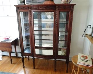 Curio China Cabinet missing a piece of glass
