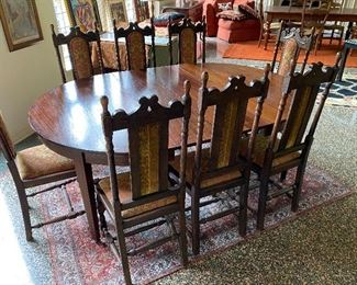 WONDERFUL SET OF 10 JACOBETHEN STYLE CHAIRS FROM THE 1920'S AND A BEAUTIFUL MAHOGANY CIRCA 1900 DINING TABLE WITH STRING INLAY ( NOT SHOWING 2 EXTRA LEAVES OR THE TWO EXTRA CHAIRS)