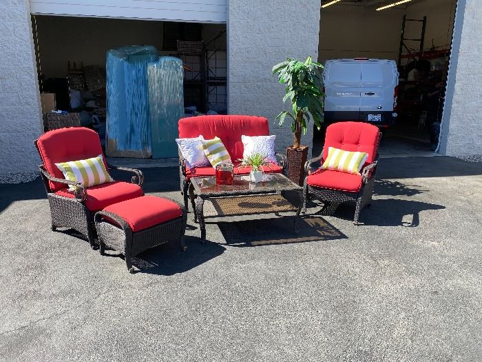 Around half a dozen different outdoor patio sets, sectionals & tables