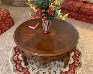 Round coffee table, round rug, and floral decor