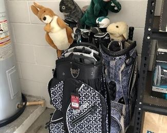 Golf clubs and bag.  One bag has never been used