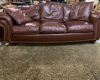 Thomasville Marrakech buttery leather couch with oversized nail trim.