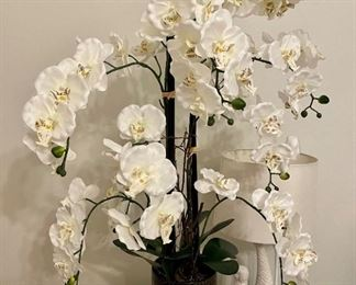 Silk orchid flower arrangement.