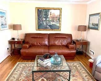 Motorized reclining leather sofa - in like new condition.