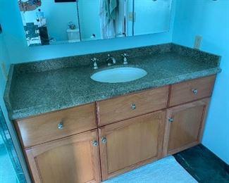 granite counter, cupboards, sink