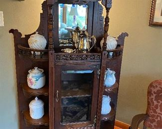 Wonderful, unusual etagere with beveled mirror and beveled glass door.