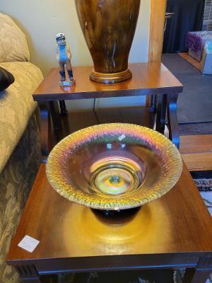 Stretch glass iridescent bowl on black amethyst glass base