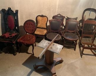 Wide selection of antique chairs. Oak top table