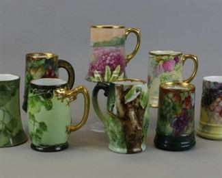 "18 Limoges & Bavarian Porcelain Mugs8 hand painted porcelain mugs. With gilt dragon form handle, J&C Bavaria; and 7 Limoges France: JP (Jean Pouyat); 2 Coronet , 1 artist signed; 4 T&V (Tressemanes & Vogt ) including pair, 1 signed M Cole, 1 artist initialed and dated Easter 1907. Tallest 5 3/4""H"