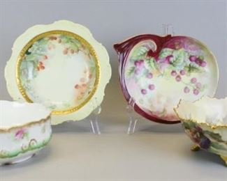 """24 Limoges Porcelain Serving Bowls4 hand painted porcelain serving bowls. Coiffe Limoges footed bowl with blackberry and flower decoration and gilt painted rim and feet, 4""""H x 10 1/4""""-diameter; unmarked dish, with raspberry decoration, artist initialed and dated on the underside, 10 1/2""""L; AL Limoges (A. Lanternier & Co) bowl with gilt rim and floral decoration, 3 1/2""""H x 9""""-diameter; GDA France serving bowl with strawberry and gilt decoration, 1 3/4""""H x 9 3/4""""-diameter. Losses to gilt on Lanternier bowl."""