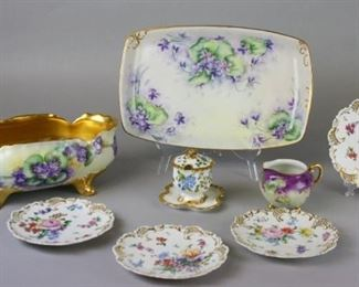 """3Grouping of German and Austrian PorcelainJ. & C Malmaison-Bavaria gilt and floral hand painted porcelain center bowl, 4 1/2""""h x 12""""w x 6 1/2""""diameter; Porzellanfabrik Fraureuth gilt and floral hand painted platter, 14""""L x 9""""W, some minor scratching on paint from use; O&EG Royal Austria gilt and floral hand painted footed creamer, 3""""T x 4 1/2""""W, some paint wear from use; four artist initialed gilt and floral hand painted dessert plates with fretwork accents, each plate different design, with Vienna Austria mark, 6 1/2"""" diameter, artist initialed Rosenthal gilt and hand painted condiment/sugar bowl, marked R.C. Monbijou, Germany, 3 1/2""""T x 4""""W, no chips"""