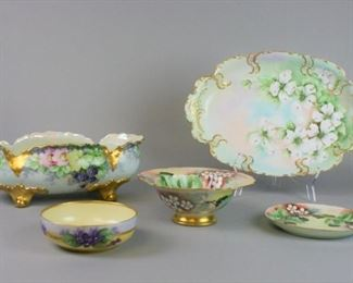 """7Continental Porcelain GroupingLot includes hand painted gilt and grape motif footed bowl, marked Bavaria, 13""""L x 6 1/2""""W, no chips; Sevres hand painted gilt and floral platter, 15""""L x 10""""W, some paint wear from use, small chip; artist signed hand painted gilt and grape motif bowl marked Vienna Austria E. Ten Eyck. 1909, 3""""T x 8""""W; matching under plate marked T&V Limoges France, E. Ten Eyck 1909, 6 3/4""""diameter; hand painted artist signed gilt and floral small bowl, marked B&C France, 5 1/2""""diameter, no chips"""