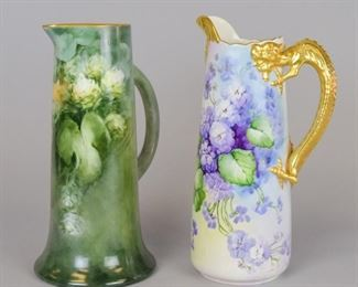 """62 Jean Pouyat Limoges Tankards2 hand painted French porcelain tankards. 1 with gilt painted dragon handle and figural spout, signed on the underside MM Gryhon. Both with JPL France (Jean Pouyat Limoges) marks. 11""""H and 11 1/2""""H"""