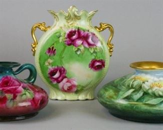 """9Grouping of 3 Limoges Porcelain VasesJean Pouyat Limoges hand painted rose motif vase with gilt handles and trim, 9 1/2""""T x 9 1/2""""W; Jean Pouyat Limoges squat vase with rose motif, 8 1/2"""" diameter. hand painted gilt and lotus motif squat vase marked T&V Limoges, 5""""T x 10""""W, no chips"""