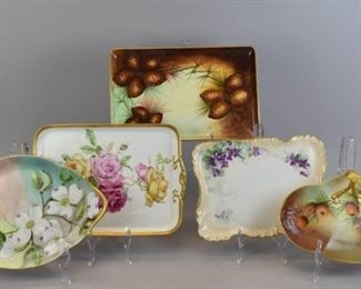 "10Limoges Porcelain Hand Painted Platters & NappyT&V Limoges (Tressemanes & Vogt) oval 2 handled platter, 13""L; GDS Limoges rectangular platter, 13""L x 9""W; H & Co. Limoges (Haviland & Co.) rectangular platter, 11""L x 8""W; T&V rectangular platter with pinecone decoration, 13""L x 8 1/2""W; unmarked nappy with gilt painted handle and pinecone decoration, 11""L"