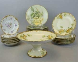 """12Group of Limoges Plates and CompoteLot includes four JP Limoges gilt and floral bread and butter plates, 7 1/2"""", one chipped on bottom; six JP Limoges gilt and yellow rose motif bread and butter plates, 7 1/2"""" diameter, no chips; six small hand painted artist signed Charles Ahrenfeldt marked CA Limoges gilt and orange motif plates, 7""""diameter, no chips; hand painted artist signed Charles Ahrenfeldt marked CA Limoges gilt and orange motif footed bowl, 4 1/2""""T x 9""""W, no chips; six small A. Klingenberg and Charles Dwenger gilt and lavender floral plates marked AKCD Limoges , 5 1/2"""" diameter, no chips."""