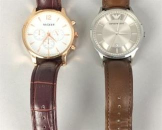 1	Migeer & Armani Watches	2 wristwatches: Migeer, gold tone with leather band; Armani, silver tone with leather band.