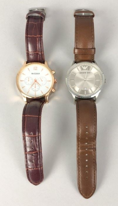 1Migeer & Armani Watches2 wristwatches: Migeer, gold tone with leather band; Armani, silver tone with leather band.