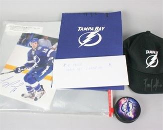 9	Autographed Tampa Bay Lightning Memorabilia	A collection of signed Tampa Bay Lightning memorabilia. Puck, signed by Vincent Lecavalier; hat, signed by Pavel Kubina; photograph, signed Teddy Purcell. Team authenticated, with COA.