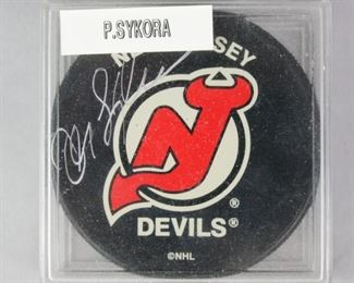 7	Petr Sykora Autographed NJ Devils Puck	Signed Petr Sykora NJ Devils NHL hockey puck, in protective case. With QPC COA