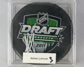 12Adam Larsson Autographed 2011 NHL Draft PuckSigned Adam Larsson 2011 NHL draft puck, in protective case