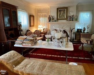 Many nice pieces here two settees , a fainting couch , secretary , oil lamps and more