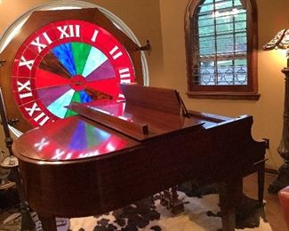 """Beautiful stained glass window.  Diameter measures 55"""" for glass alone - 63"""" including wooden frame.  It is made into a clock but clock mechanism could be removed if desired."""