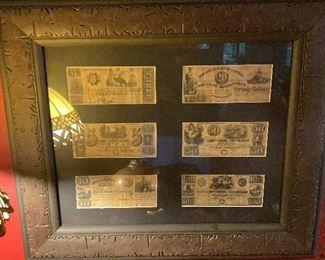 Framed Confederate bills.