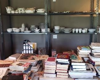 Shelves showing dishes and books