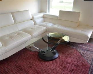 contemporary living room leather sectional and adjustable coffee table