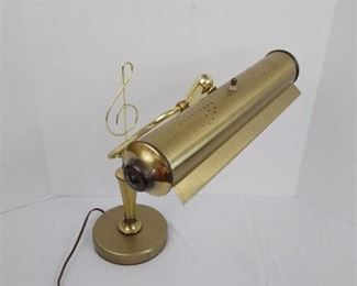 Brass music reading lamp with treble clef design